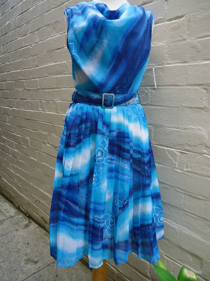 1960's swirl pattern dress in excellent condition.  Pleated skirt, cowl neck & self-belt. Size 10 $79