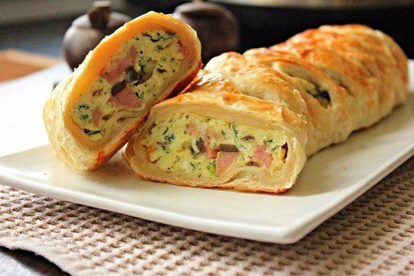 Scrambled eggs in puff pastry Ingredients: Sheet of puff pastry — 1 pc. Eggs — 6 pieces. Mushrooms — 200 g Ham — 200 g Cheese — 100 g Dill — a small bunch Butter — 1 tbsp. l. Salt and pepper — to taste Egg lubrication Preparation: 1. In a frying pan fry the …