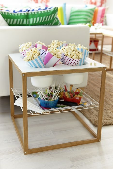 Whether you're hosting a kid's party or teen's movie night, the shelf and four removable bowls of the IKEA PS table are a help to busy hands.