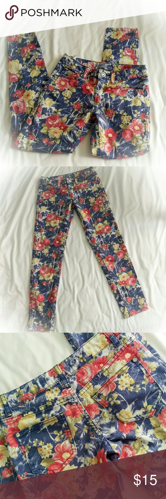 Girls' Karma Blue floral jeans Really cool vintage-style floral skinny jeans in excellent condition, no defects! They have an adjustable waist. Brand is Karma Blue, who has unfortunately stopped producing but used to sell their boho/rocker style denim at stores like Urban Outfitters, Tilly's and Charlotte Russe. I wish they'd come back because they made the greatest jeans. Scoop them up before they all disappear! Karma Blue  Bottoms Jeans
