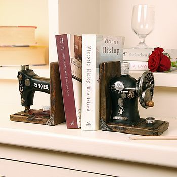 Vintage Singer Sewing Machine Book Ends; old machine cut in half; Upcycle, Recycle, Salvage, diy, thrift, flea, repurpose, refashion! For vintage ideas and goods shop at Estate ReSale & ReDesign, Bonita Springs, FL