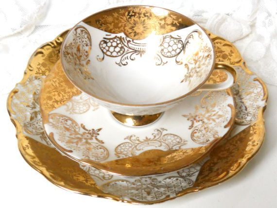 Gorgeous vintage teacup trio with a beautiful gold decoration on off white porcelain. It was made by Winterling, Bavaria, Germany, in the fifties