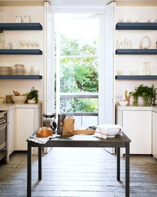 open blue shelves in white kitchen. / sfgirlbybay