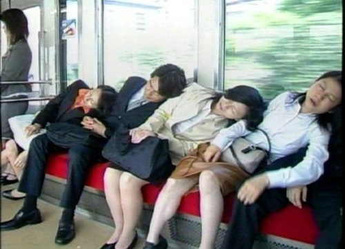 Common scene on Japanese trains. These people would most likely be strangers.