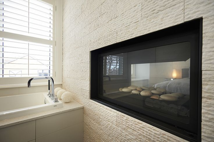 Double sided fireplace in master ensuite