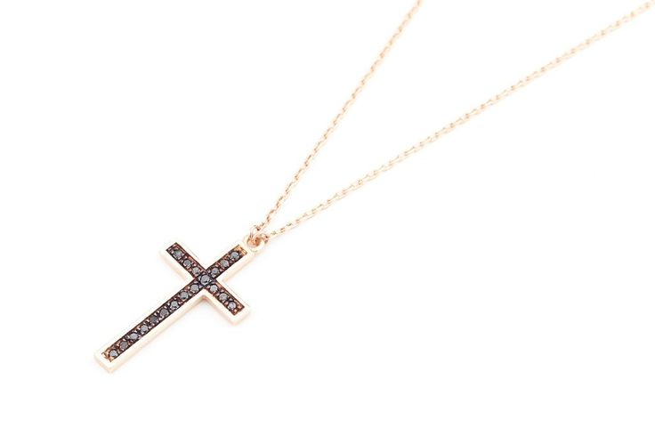 Classic traditional cross with black diamonds set in 14K gold.