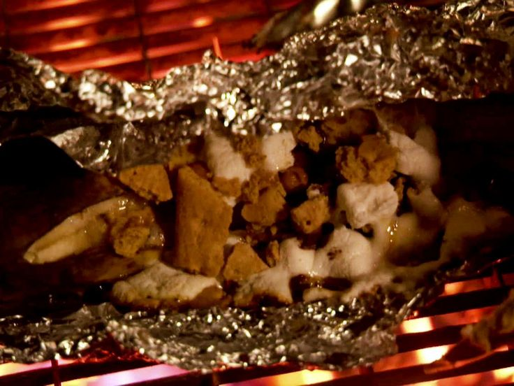 Came out good, not amazing, but fun. I made them for my Familia, in foil packets, using peanutbutter chips and cinnamon graham crackers; the rest of Ree's recipe will be the same. A grilled dessert is different, the kids' anticipation and not heating up the house--worthwhile considerations.  Source: Campfire Banana Boats recipe from Ree Drummond via Food Network