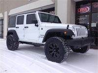 2014 Jeep JK 2.5 Inch Lift  2.5 inch Rough Country Lift Kit on 18x9 Helo Wheels and 33 inch Toyo ATIIs