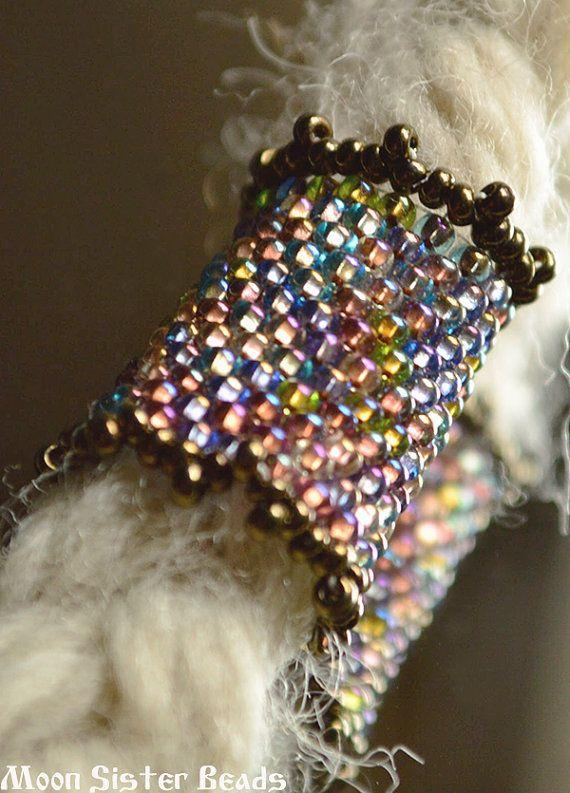 Hey, I found this really awesome Etsy listing at https://www.etsy.com/listing/191898413/rainbow-gunmetal-dreadlock-bead-sleeve