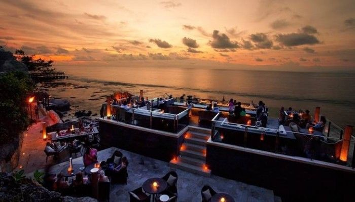 The Rock Bar, Bali, Indonesia - Bali's bar scene is legendary – from beach bar Bintangs to high rise hotel clubs, you're never far from a drink and a killer view. But if there's one spot you need to settle in for a sunset session, it's this famous bar. Perched out over the cliffs on the Jimbaran coastline, the Rock Bar has 180 degree views out over the ocean. The bar itself is part of Ayana Hotel, but you don't need to be a guest to partake in cocktails with a side of sunset.