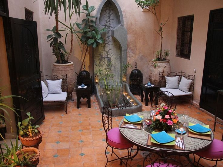 Serene fountain within this Moroccan vacation rental is perfect for relaxing!