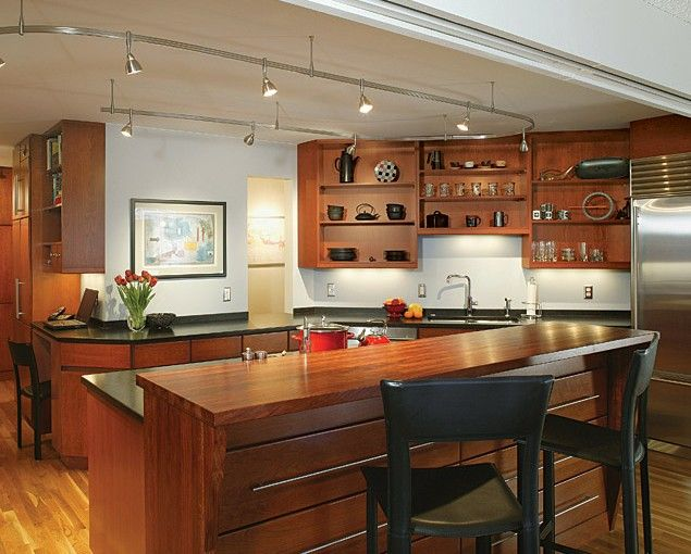 Minneapolis Modern Condo Kitchen Remodel with cherry cabinets and black countertops