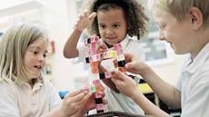 Preschoolers assembling block units in a classroom   Understanding Dyspraxia