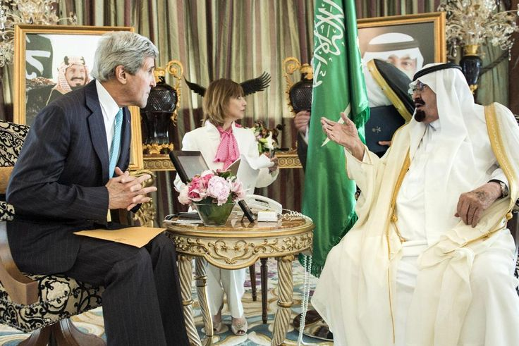 US Secretary of State John Kerry listens as King Abdullah speaks before meeting at the King's private residence Friday, June 27, 2014 in...