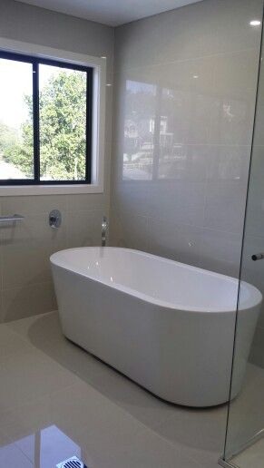 Pale Grey polished porcelain tiles available at toptiles.com.au
