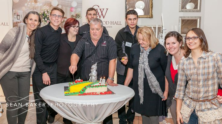 The team celebrating 10 Years at Calderwood Hall. Photo by @seanbakerphoto