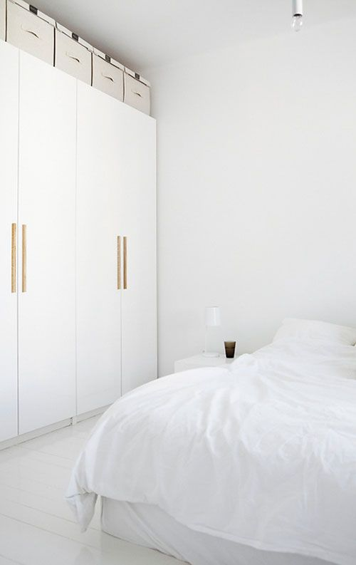 white wardrobe with wooden handles | images by Mikko Ryhänen / Scandinavian Deko | via THE STYLE FILES