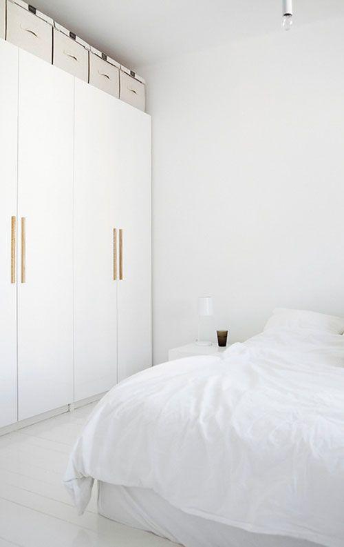 white wardrobe with wooden handles | images by Mikko Ryhänen / Scandinavian Deko | via THE STYLE FILES