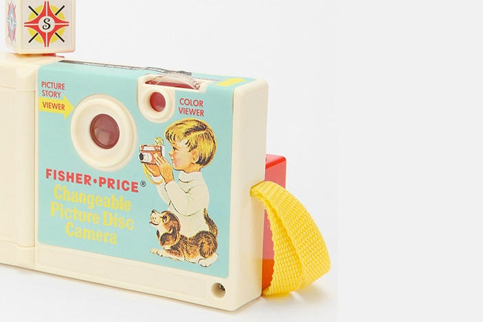 Fisher Price Camera    Includes a photo album too! Available at the little dröm store.
