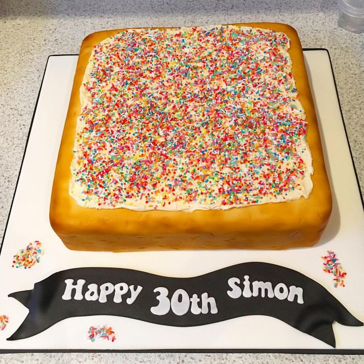 Never too old for fun! Chocolate Mud cake disguised as a piece of fairy bread for a 30th birthday. Ganached, covered in fondant and then airbrused and topped with white chocolate truffle and 100's & 1000's