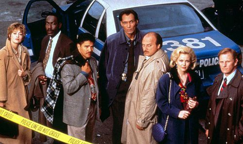 "Cast photo for ""NYPD Blue."" Left to right: Sharon Lawrence, James McDaniel, Nicholas Turturro, Jimmy Smits, Dennis Franz, Gail O'Grady, and Gordon Clapp."