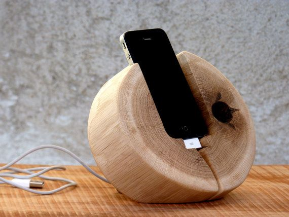 Natural wood iPhone docking station. Handmade by WoodRestart. So this is pretty freaking awesome.