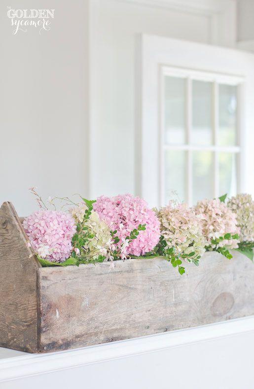 Gorgeous pink hydrangeas in vintage tool box