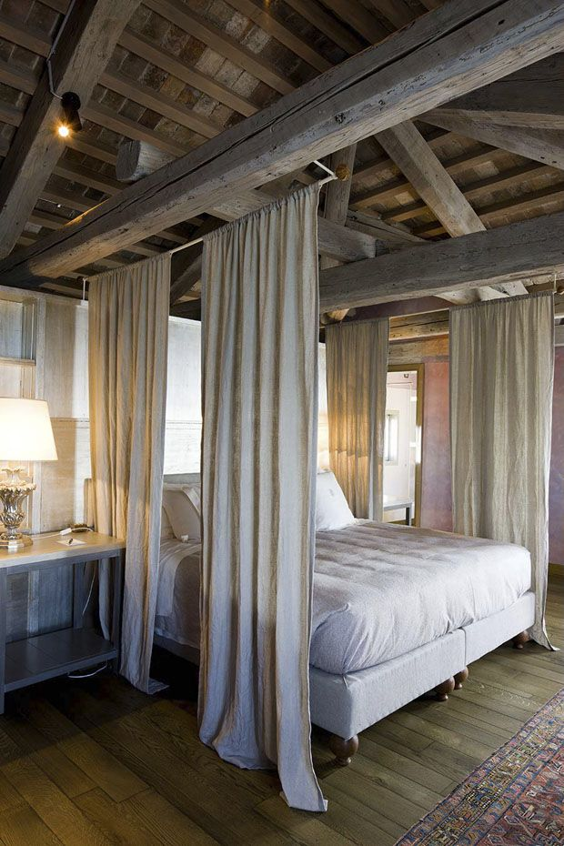 Beamed bedroom, vaulted ceiling, exposed beams, Hotel Veneza vilaf,  photography by Filippo Bamberghi