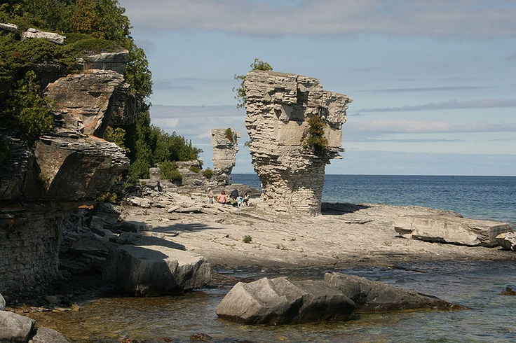 Flowerpot Island, Tobermory, Ontario, Canada... note the people at left of base.