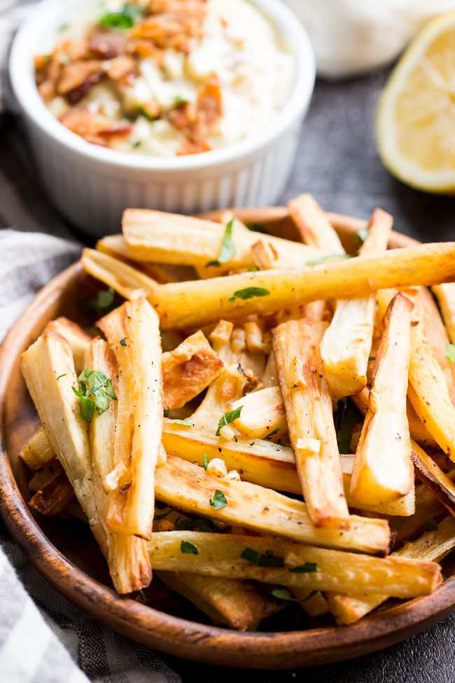 These crispy baked garlic parsnip fries are easy, lower in carbs than potato fries and are served with a bacon aioli for dipping. Paleo and Whole30.