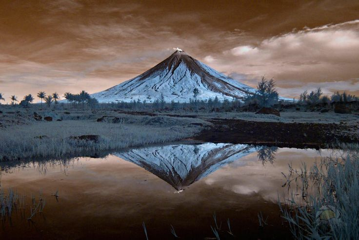 Mayon Volcano, also known as Mount Mayon, is an active volcano in the province of Albay, on the island of Luzon in the Philippines  - http://earth66.com/infrared/mayon-volcano-known-mount-mayon-active-volcano-province-albay-island-luzon-philippines/