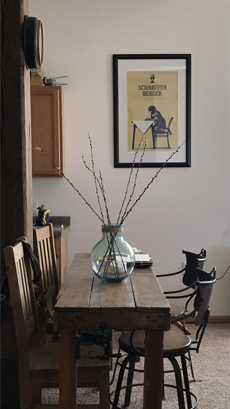 Warehouse apartment. Farm table with blue bubble vase from hobby lobby and cattails.