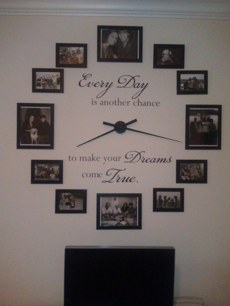"This is my new wall clock for my living room with hands that really work. I used black and white photos, black frames from ikea, clock hands from ebay, and a vinyl quote i ordered from a website. It's 36"" diameter."