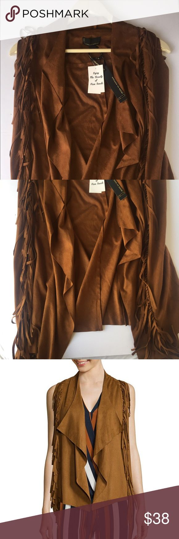 Faux Suede Fringe Vest Go full retro chic with this faux suede vest, with great fringe that gives it character & edge. i jeans by Buffalo Jackets & Coats Vests