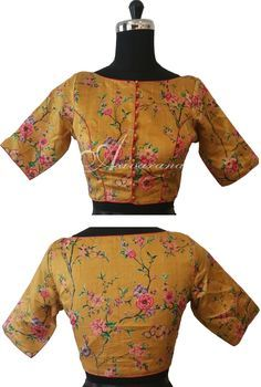 Floral print raw silk blouse with beautiful red piping. The boat neck makes it trendy.