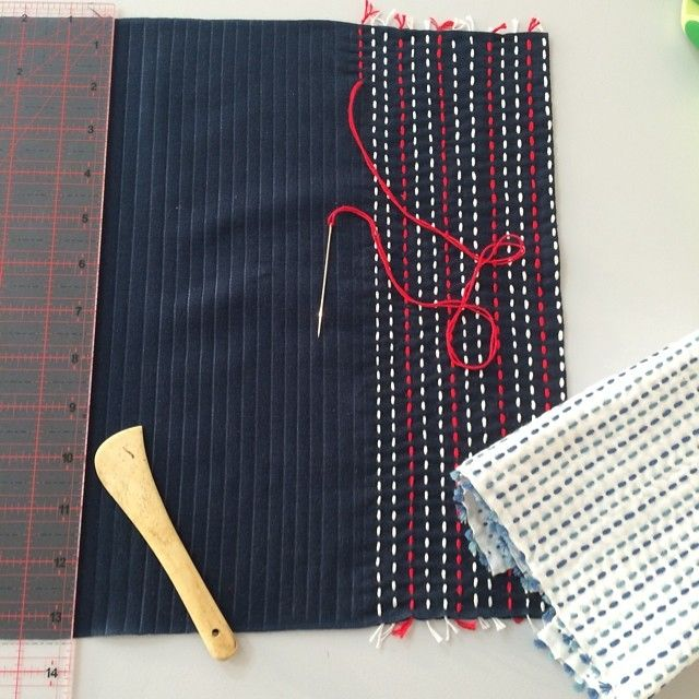Making sashiko stitched cloth.Using a Hera to mark the lines on the fabric!