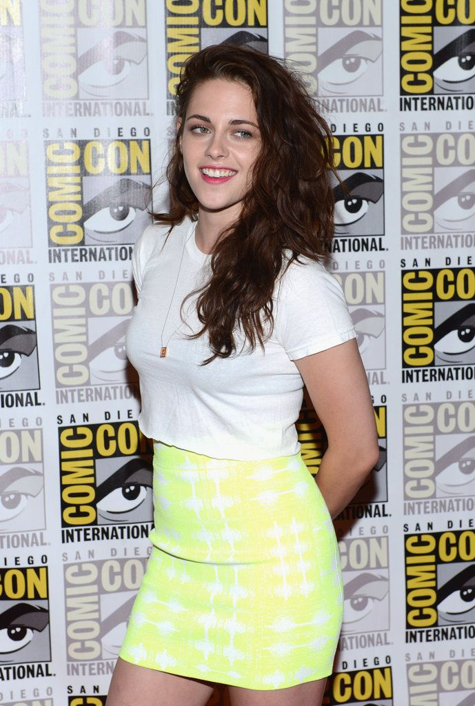 Kristen Stewart in a white tee & yellow BCBG skirt at ComicCon