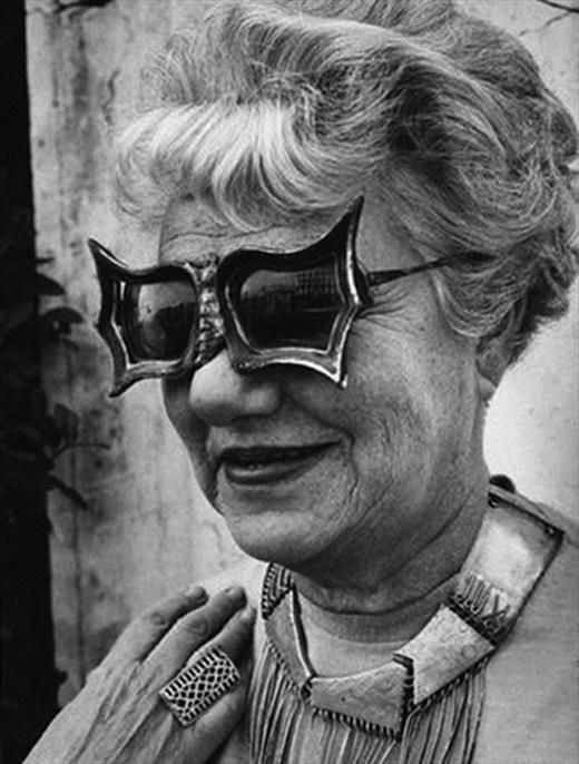 "Peggy Guggenheim in Venice, Italy late 1950, was the daughter of the American businessman Benjamin Guggenheim who went down with the Titanic ship. Peggy inherited a fortune from her father and became an influential collector of modern art. She was the niece of Solomon R. Guggenheim and married the artist Max Ernst. . . . ""Having plenty of time and all the museum's funds at my disposal, I put myself on a regime to buy one picture a day."""