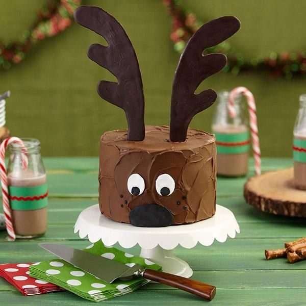 Christmas Reindeer Cake - This reindeer is ready to deliver a delicious Christmas to your family. It's a cake you can decorate with ease, topped by giant antlers made with Wilton Dark Cocoa Candy Melts Candy.