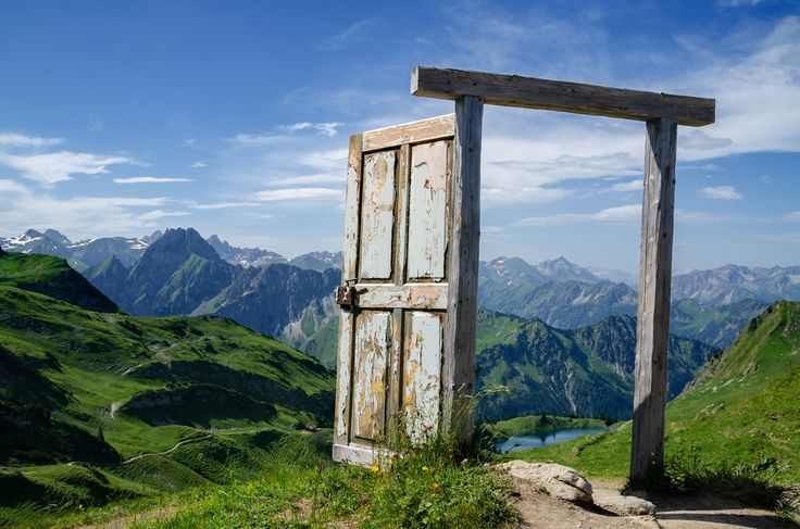'Still Standing' - photo by Dominic Walter, via 500px;  The old wooden door was standing loose along the trail leading to the Seealpsee (which you can see when you look through the door).