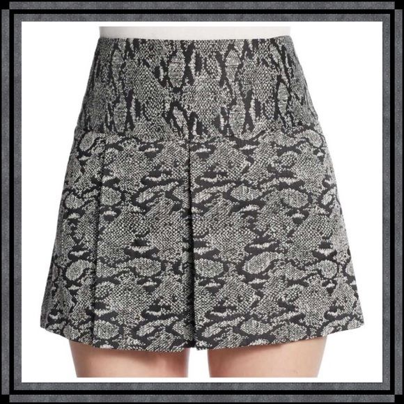 "Flared Snake-Print Skirt from Saks Off Fifth Flirty, pleated mini in an exotic snake print. Back zipped, lined. Polyester/Cotton/Rayon. Approximately 14.5"" long. NWT. Saks off Fifth Skirts Mini"
