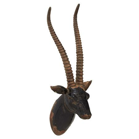 Lend a touch of safari-chic charm to your gallery wall with this faux gazelle's head decor, or hang it in the master suite and let it catch scarves and ne...