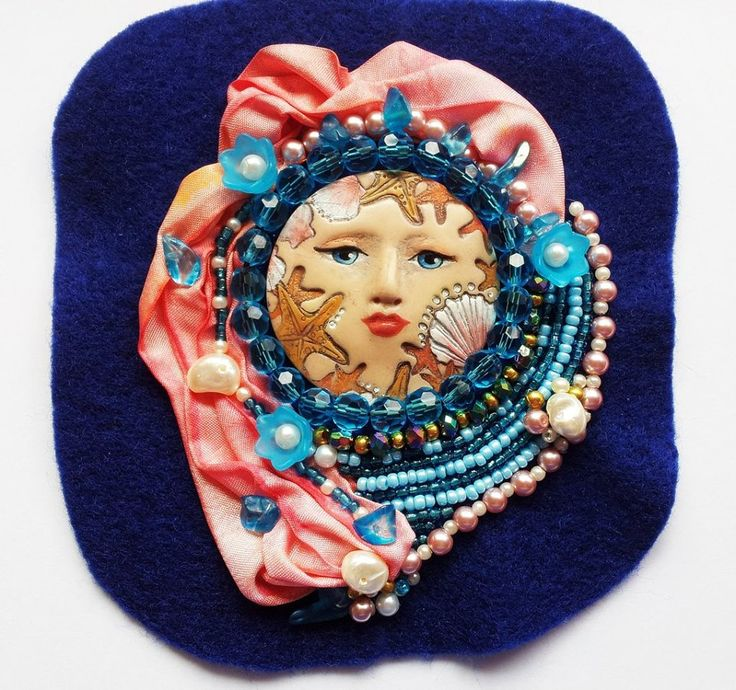 Stunning Polymer Clay Sea Angel face pendant. Quality beads and Natural Pearls with hand dyed silk ribbon. Ready to be used on projects . Sewn onto pure wool felt , no backing . $55 + postage (AU)