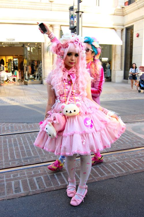 Japanese street fashion. Kawaii inspired accessories, pink and white with tutu.