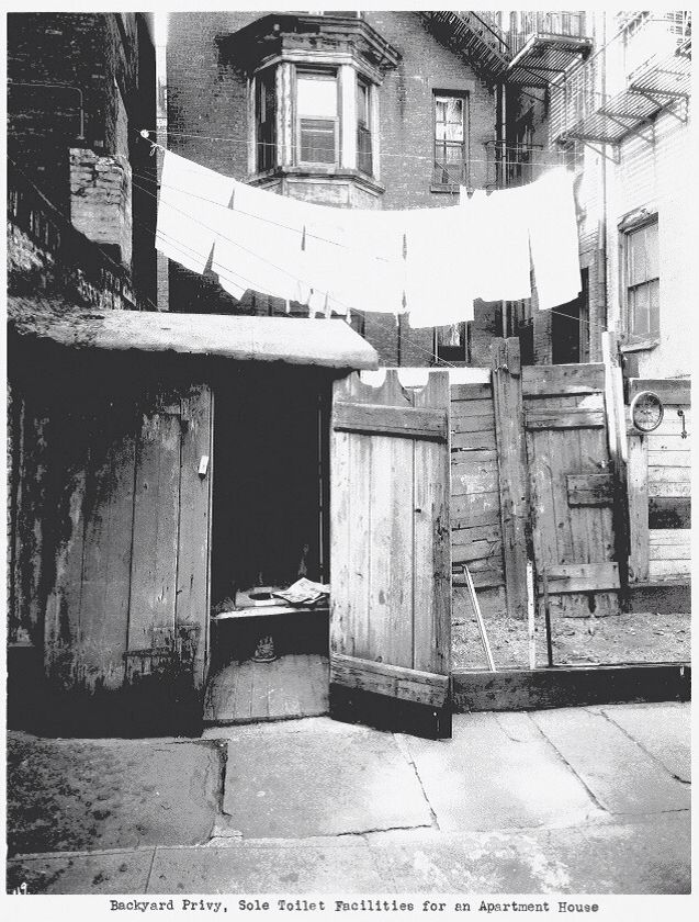 Backyard Privy. Sole toilet facilities for an apartment house in NYC.