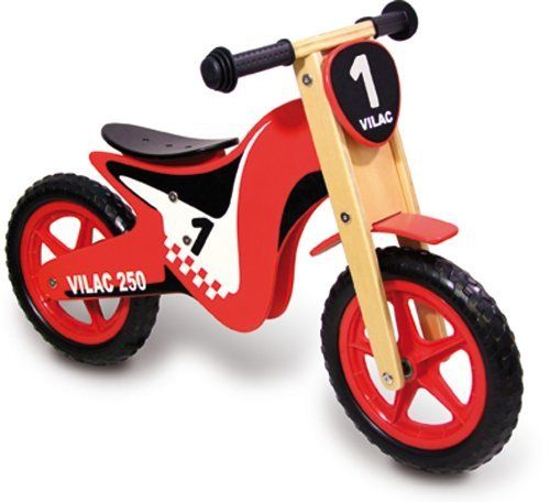 Vilac Balance Bike Cross by Vilac. $131.90. Gross motor skill development. Ages 3 and up. Vilac has been the maker of high quality, award winning toys since 1911. Hard wearing and safe push along bike. A beautifully crafted wooden push along balance bike cross made by well-respected toy makers Vilac. The bike has a sturdy, hard wearing design, with a sporty, dirt bike appearance, perfect for any little adventurer. The wooden scooter is a bright red, black and white, w...