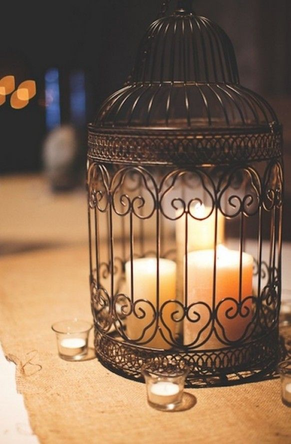 Rustic theme with bird cages but we can add coral and mint flowers. It would be so cuuute!!
