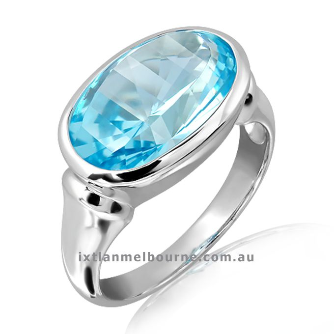 Let the Jewellery that you wear talk of who you are ! This a Laser Technology faceted Blue Topaz Stone set in Sterling Silver (Rhodium Plated) ring. Exclusive by Ixtlan Melbourne Jewellery Store in Gertrude St Fitzroy