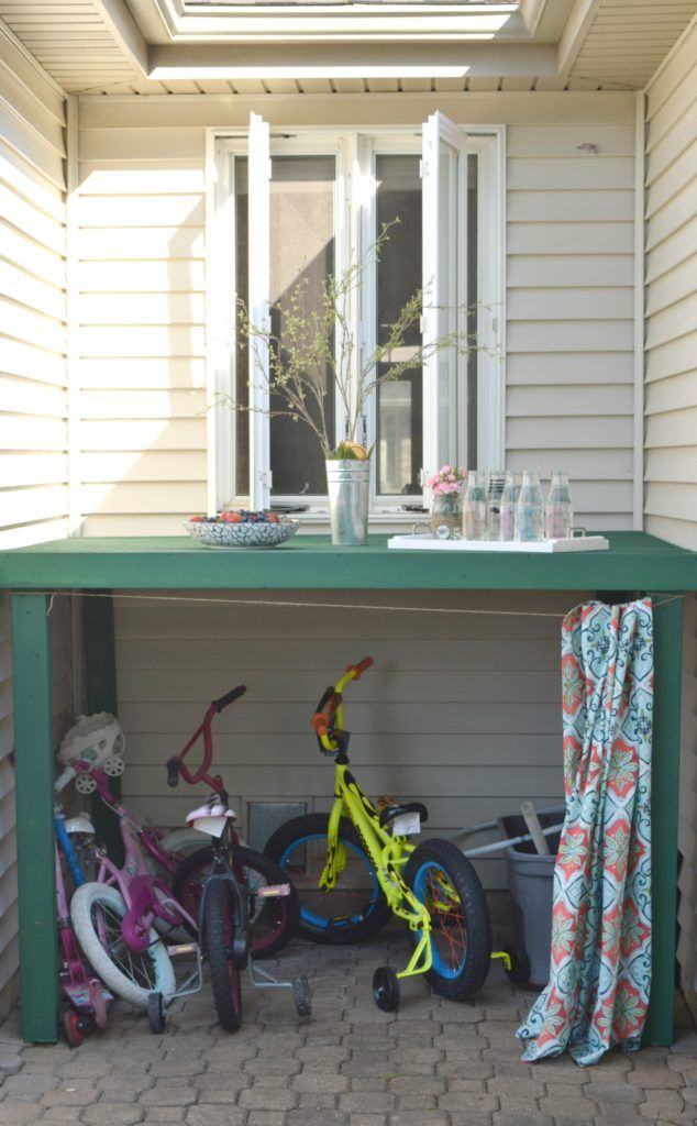 kids toy outdoor storage, how to make a bike garage. celebrating outdoor living, how to add function, style, and a casual space to relax. Sharing simple solutions, DIY projects, and storage ideas for toys. To see more click on the post or visit-  http://ourhousenowahome.com/