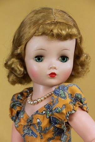Vintage Madame Alexander Cissy doll wears rare tagged orange bird print day dress.